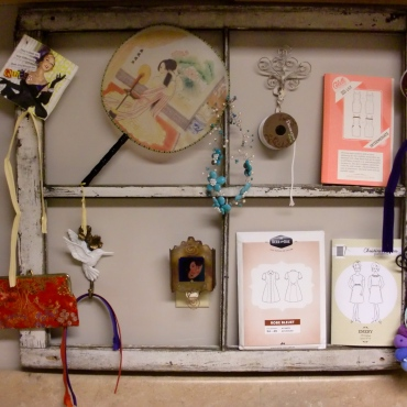 A shabby old window to organize odds and ends.