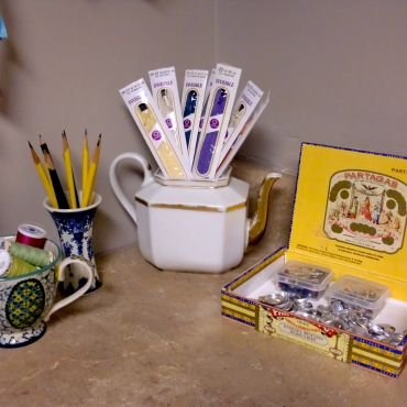 Zippers in a teapot, of course! And buttons to cover in a cigar box. Where else?